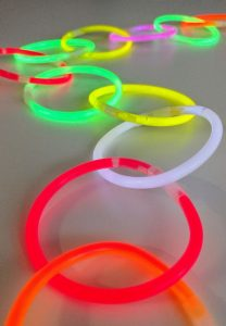 glow stick party chain made from glow bracelets linked together
