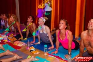 students at a glow stick yoga class