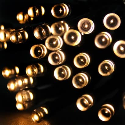 100x warm white led multi function lights on a dark green 8 metre power cable